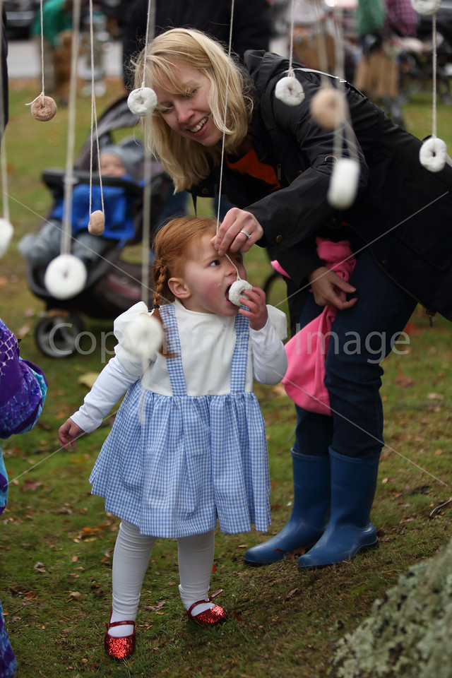 Dressed as Dorothy from the Wizard of Oz, Ava Caulfield gets a little help from mom, Marin Caulfield.