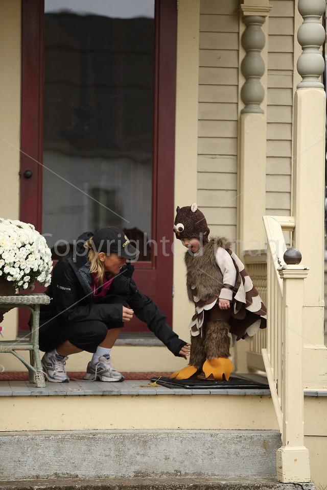 Kim L'Ecuyer checks out Wyatt Evans owl costume.