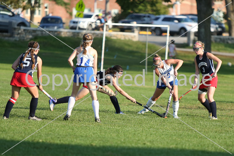 Defender Ella Corbett gets to the ball first.