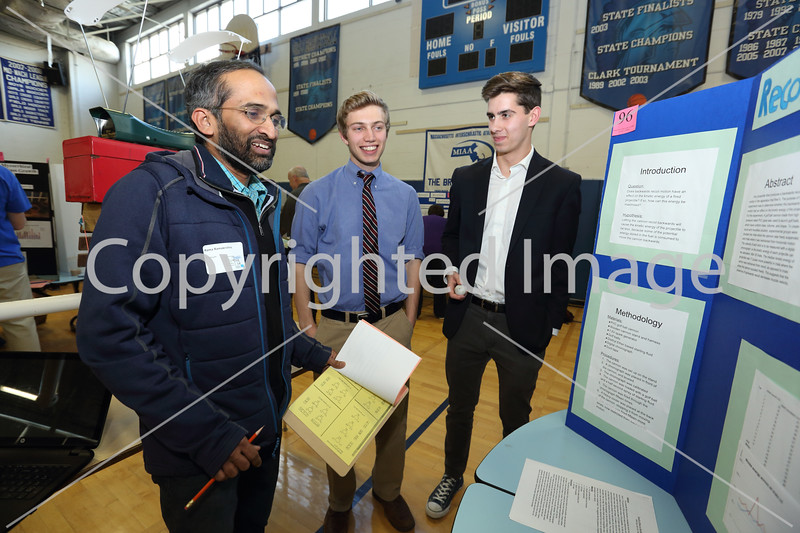 """From left: Judge Rama Ramakrishan reviews """"Recoil versus Muzzle Energy,"""" Will Day and Jon Gall's project."""