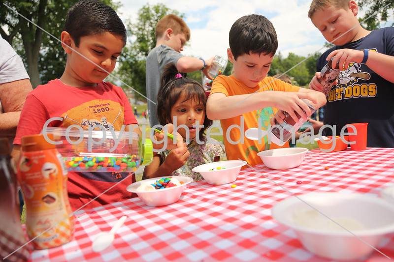 From left: Arnav Kharti, Radha Rahanne, and Colin Glynn put fixins on their ice cream.