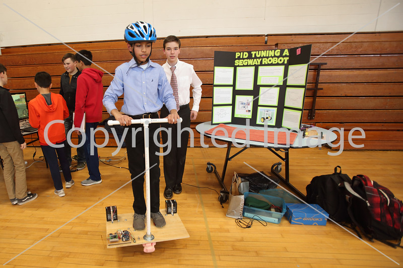 Shaan Patel rides a homemade Segway robot using<br /> PID (proportional integral derivative) controllers as his science fair partner, Sawyer Madison watches.