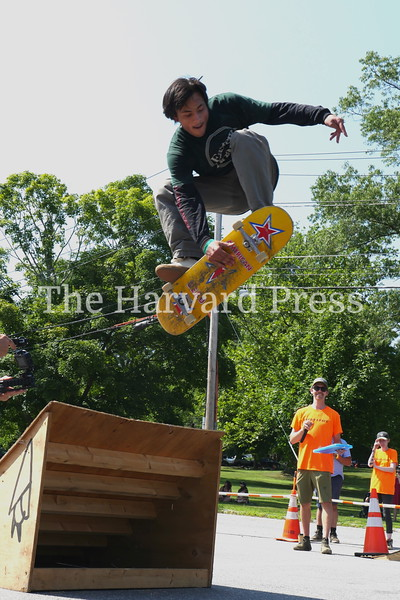 """2019 Central Mass Skateboard Festival<br /> Max Chadran of Harvard airs it out while Mike Girard judges during the """"cash for tricks"""" event."""