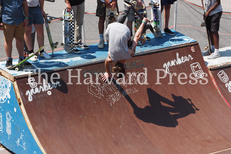 2019 Central Mass Skateboard Festival<br /> Bobby Hommel and his shadow get inverted with his signature hand stand during the mini ramp open skate.