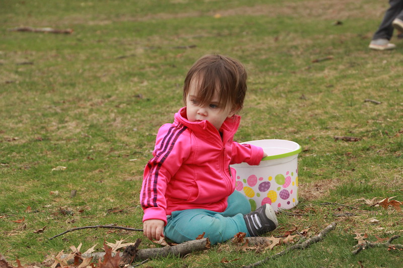 Seventeen-month-old Eva Schiering takes a rest halfway up the hill.