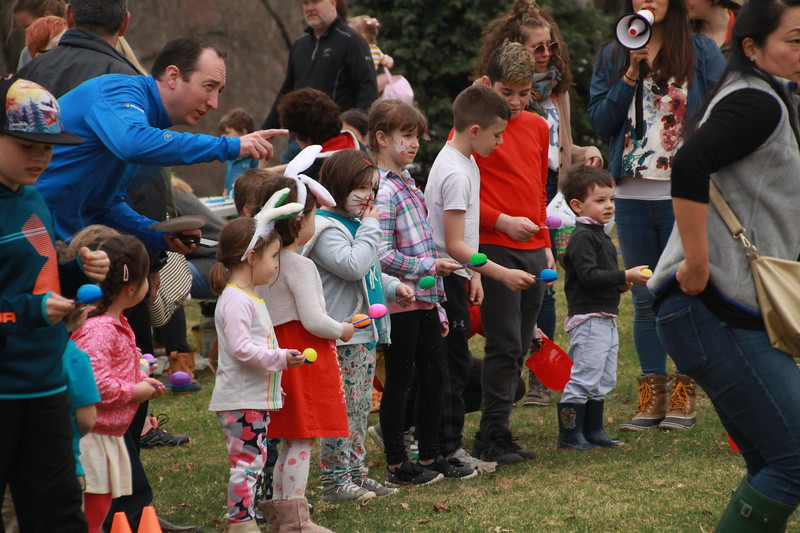 Children line up for the start of the egg-on-spoon race.