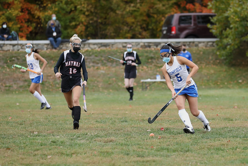 Claire Stoddard maneuvers past her opponent in an Oct. 12 field hockey game agains Maynard. (Photo by Lisa Aciukewicz)