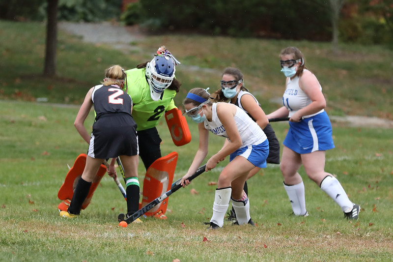 Goalie Hannah Bauhover watches as co-captain Annie Segaloff hits the ball away from the goal.  (Photo by Lisa Aciukewicz)