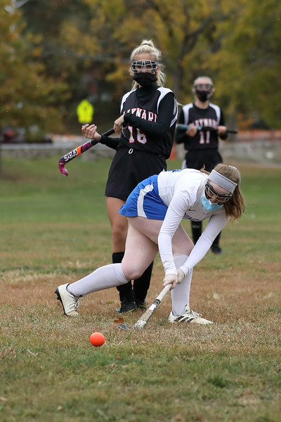 Co-Captian Maible Daly sends a strong pass away from a Maynard defender. (Photo by Lisa Acuikewicz)