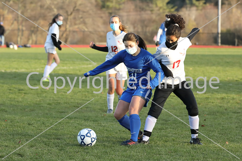 Mackenzie Hoover fights for ball positon against a Hudson opponent. (Photo by LIsa Aciuekewicz)