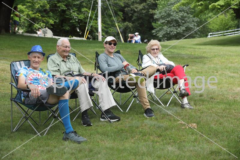 Enjoying the parade on the Common are Tom Aciukewiicz, Dave Smith, Jamie Ackiukewicz, and Bernadine Aciukewicz.