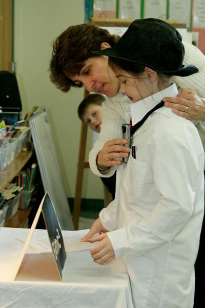 Arlene Sullivan helps Lisa Jorgenson prepare as Albert Einstein.