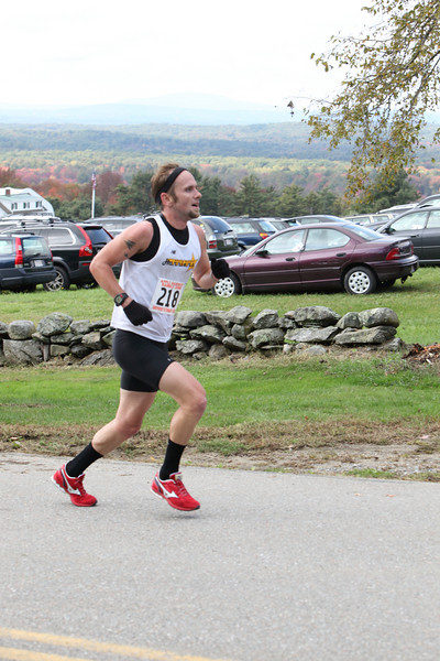 Michael Brouillette still has spring in his step as he races up the final hill in the Apple Harvest Ramble on October 5 at Fruitlands. Brouillett beat out a field of more than 200 runners to claim first place with a time of 53:45.
