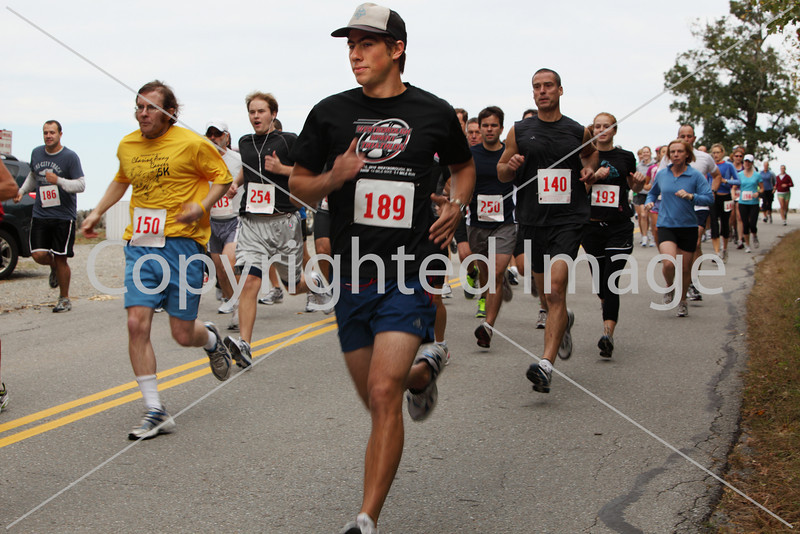 Nick Matisse of Eldridge Road leads a pack of runners downhill from the starting line.