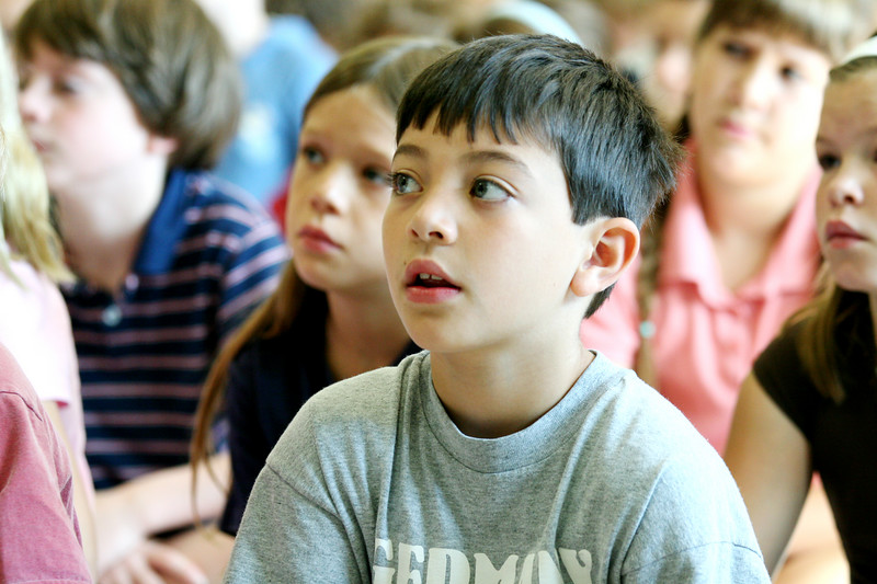 Joey Calabresi listens intently to storyteller Leeny Del Seamonds at the elementary school. (Photo by Lisa Aciukewicz