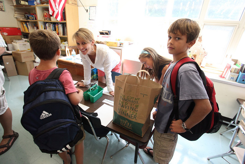 The Armstrong family checks out Jack's new digs in Mr. Snell's class at the Open House. Left to right are Will, Sherry, Kaeli, and Jack Armstrong.