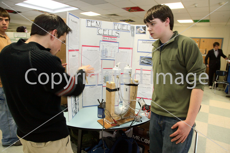 Josh Zimmer listens to a judge's question about his project on PEM fuel cells.