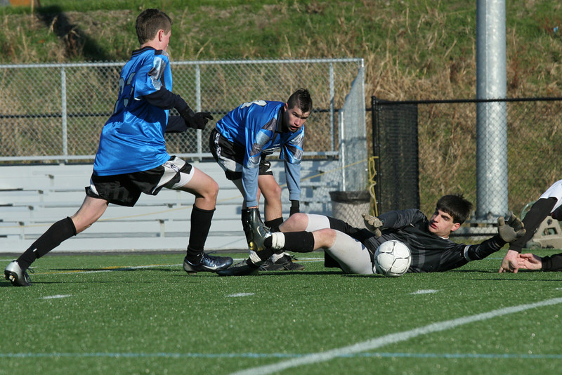 Cody Osgood and Will Schwarz try to get the ball past Maynard's goalkeeper in the district final match the Bromfield went on to win 8-0.
