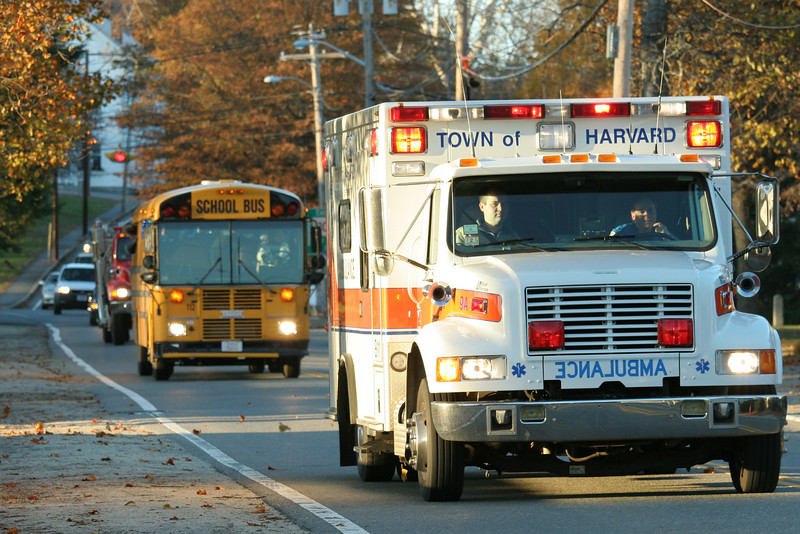 The school bus carrying the Bromfield girls soccer team gets a public safety escort into town after winning the district championship.