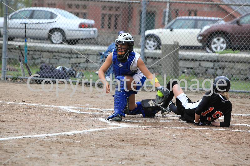 Catcher Brittany Lee tags a runner out at home plate.
