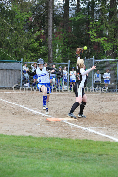 Olivia Rooney charges ahead, but still gets tagged out at first.
