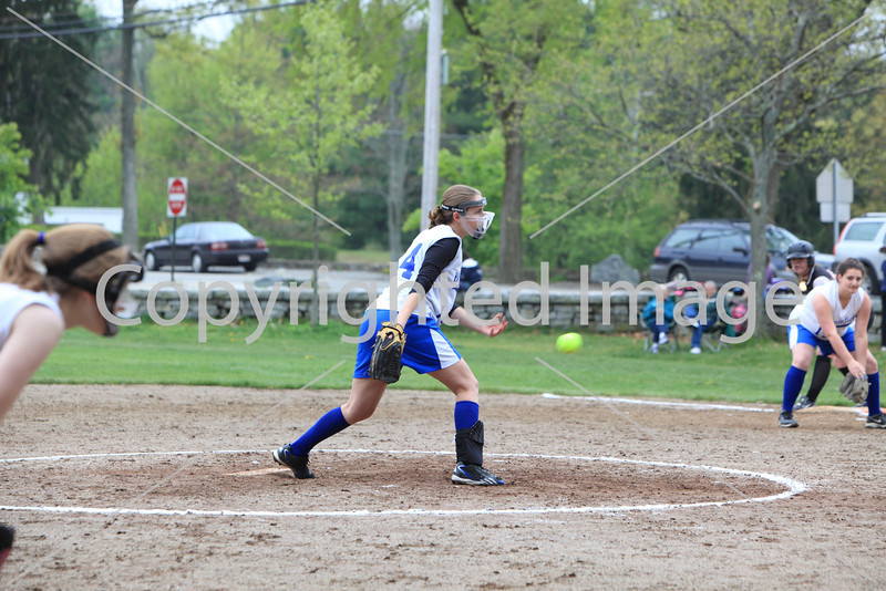 Sophomore Alison Hanlon releases a pitch in a game against Maynard.
