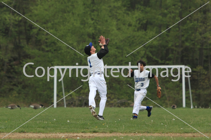 Peter Nocka (left) dives for a pop fly as Eric Hazoury races to back him up.