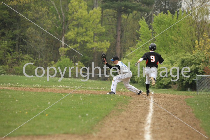 Clayton Galeski tags a runner out on first base.