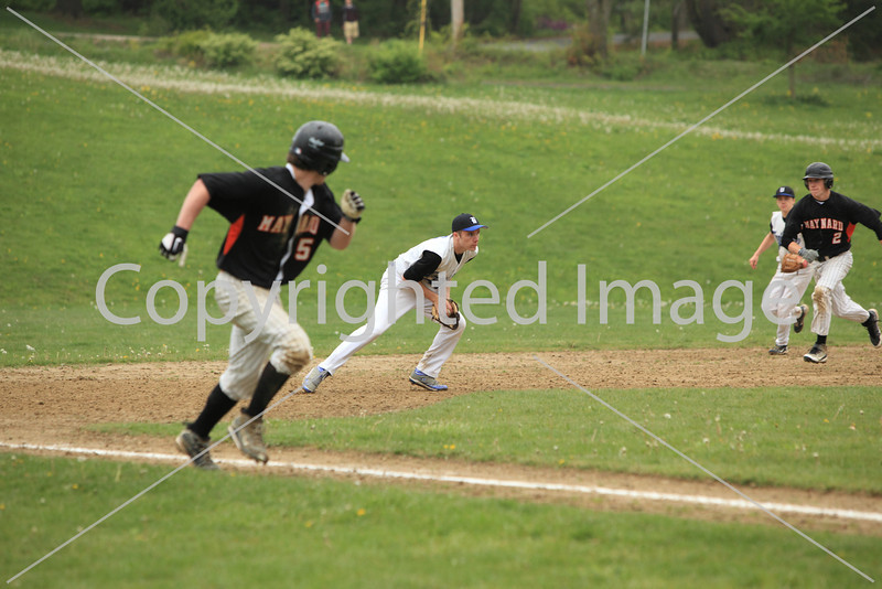 Third baseman Mike Jakovitz stops a ground ball.
