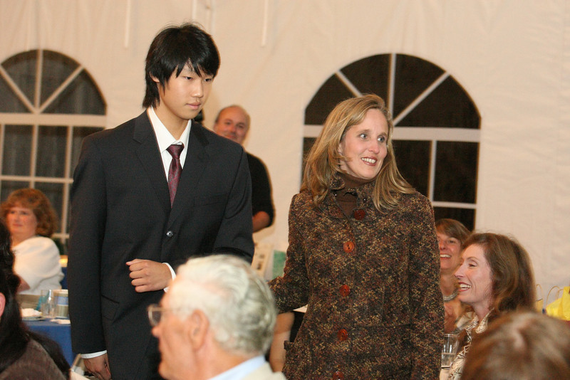 David Choi escorts Virginia Justicz off the catwalk.