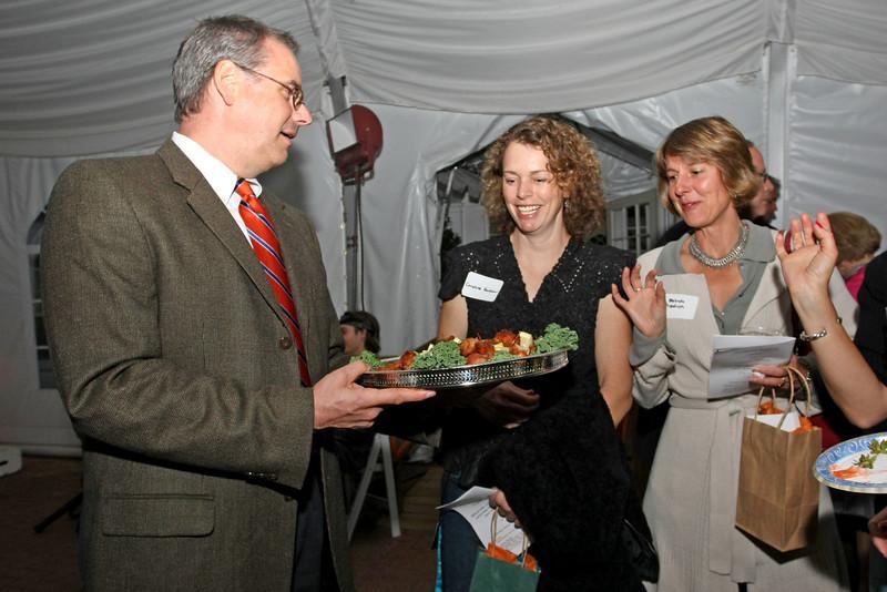 Reverend Greg Schmidt serves fried scallops to Caroline Fish Hankour and Belinda Freidrich.