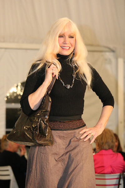 Country music star Robin Right in a mutli-tiered cotton crinkle skirt by Saga, a Kersh cable sweater, and handbag by Bagtique.