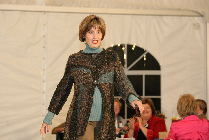Marcie Donahue in a striped boucle cardigan by Curio.