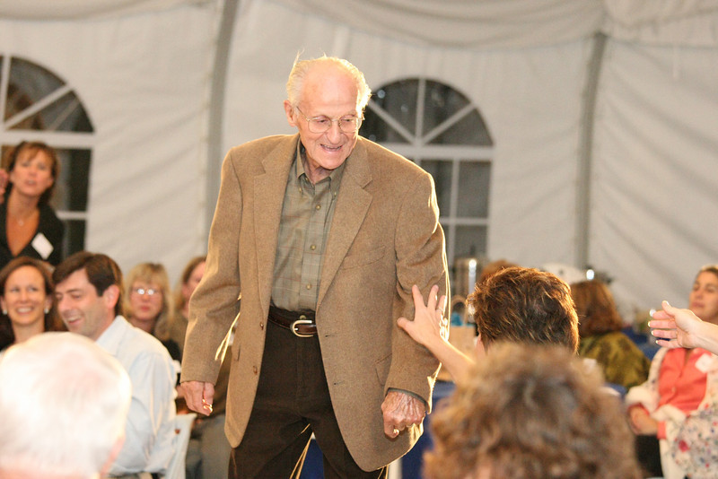 Paul von Loesecke pauses so the audience members can feel his Gould's brand taupe camel hair jacket.
