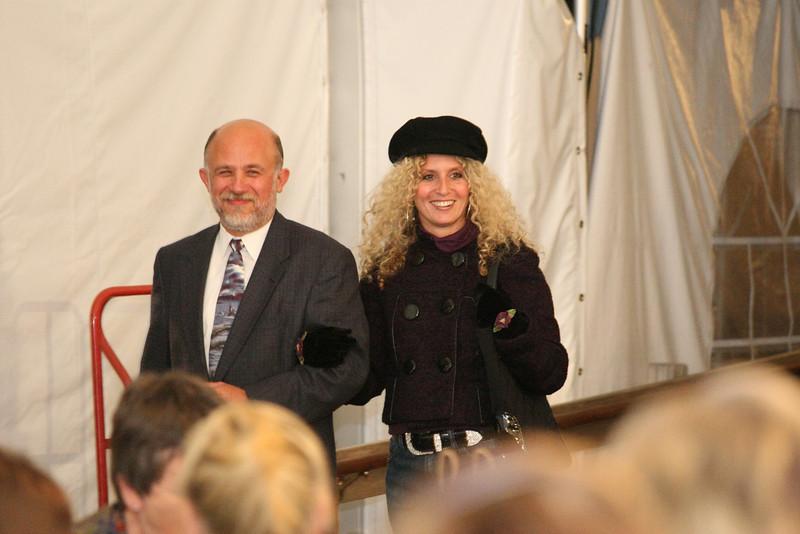 Stu Sklar escorts Jen Sundeen, the first model of the evening, to the walkway.