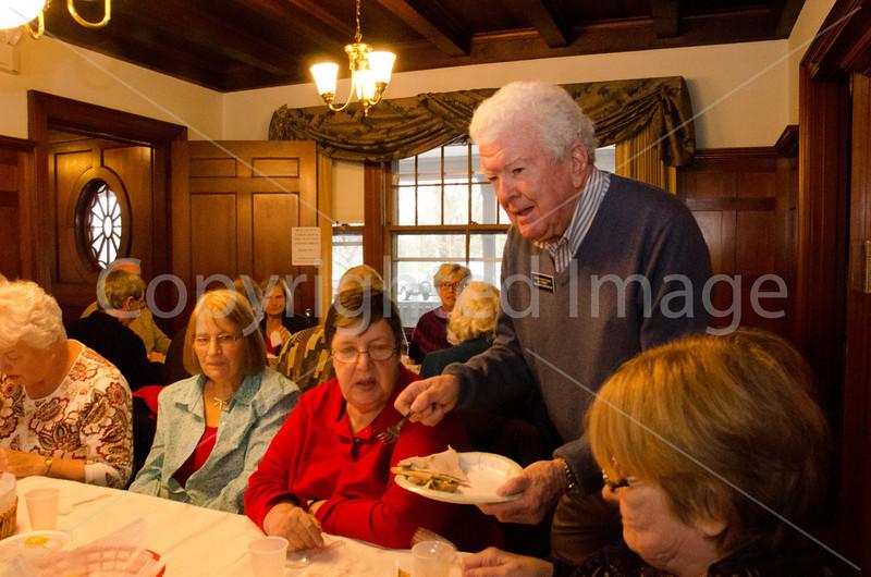 Mabel Sawyer, Charlene Renczkowski, Eileen Jansky, and Cynthia Newland being served by Bill Herbert