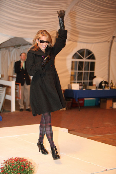 Sherri Armstrong is a show-stopper in a dramatic jet black coat by Katherine Barlclay.