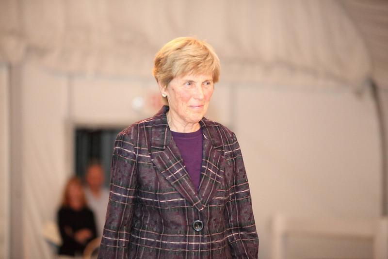 Marie Finnegan wears a charcoad and blackberry plaid blazer by Tirbal sportswear.