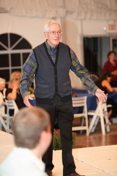 Larry Finnegan steps out in pants by Haggar, a dress shirt by Viyella, and a sleeveless hound's tooth plaid sweater by Alex Cannon.