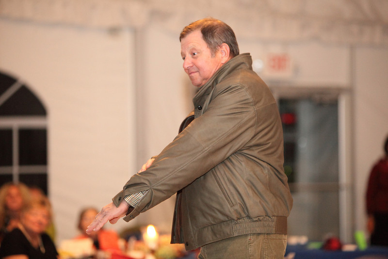 Chairman of the Board of Selectmen Ron Ricci point out the softness of  his ultra-lite leather jacket by Remy.