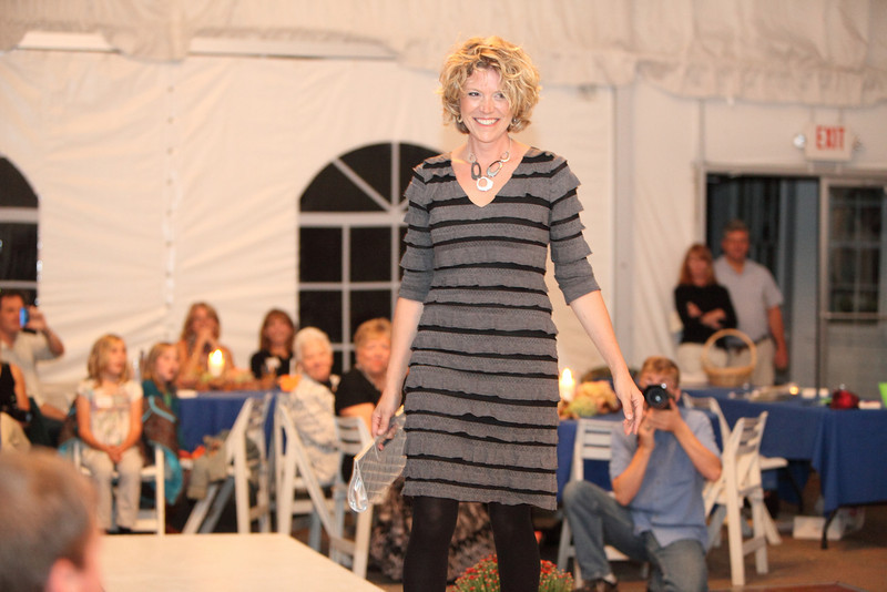 Rochelle Greayer models a fun charcoal grey ruffled dress by Frank Lyman designs--a Canadian manufacture--along with bold jewelry by Pastore.