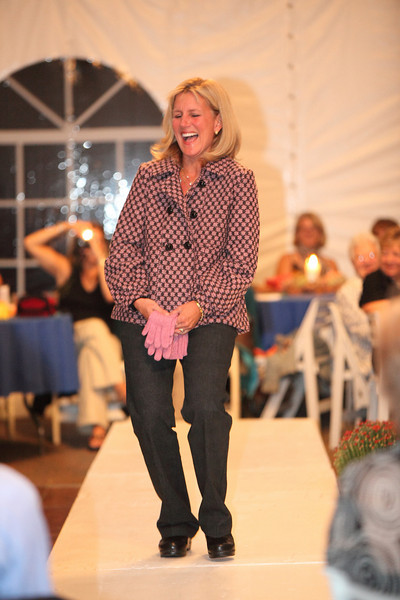 Heidi Siegrist breaks into laughter while modeling a pink and black jacket by Maestro along with snake-skin patterned jeans by Tribal.