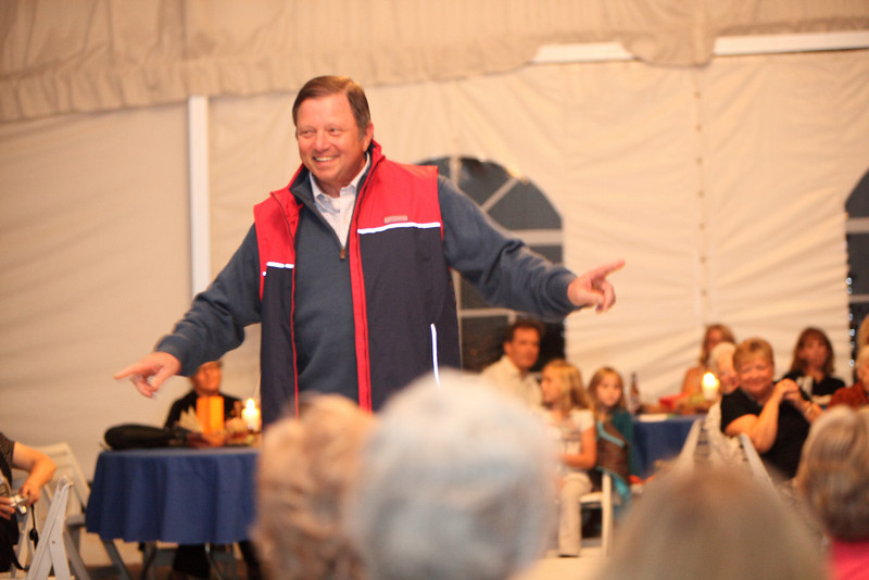 Chairman of the Board of Selectmen, Ron Ricci, strolls the runway in a Vineyard Vines outfit.