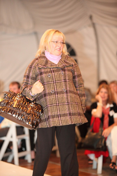 Karen Strickland looks ready for winter in a Glenn plaid jacket and Eilieen Fisher pants with a Tianni ruched metallic brown handback.