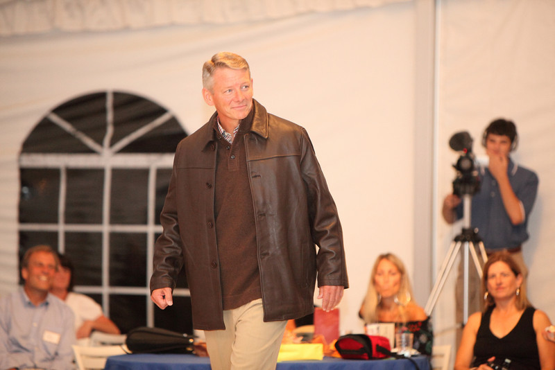 Candidate for Selectman Bill Johnson models a car-coat length leather jacket by Missani over a polo sweater and silk dress pants from Tommy Bahama.