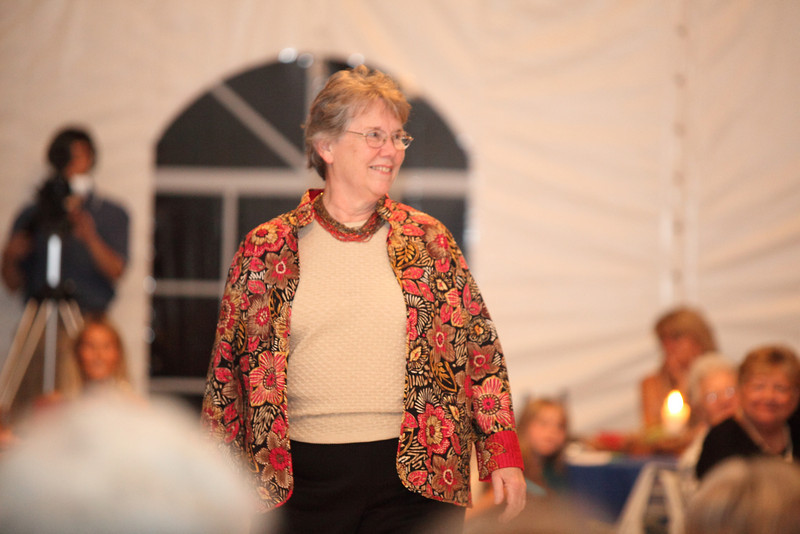 Audrey Ball of the League of Women Voters models a batik printed jacket in warm fall colors from the world market collection by Alfred Dunner.