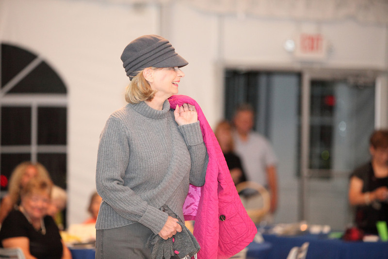 Debbie Ricci sports a turtleneck sweater by Ghant and a newsboy cap by Parkhurst offset by a bright fuchsia quilted jackt.