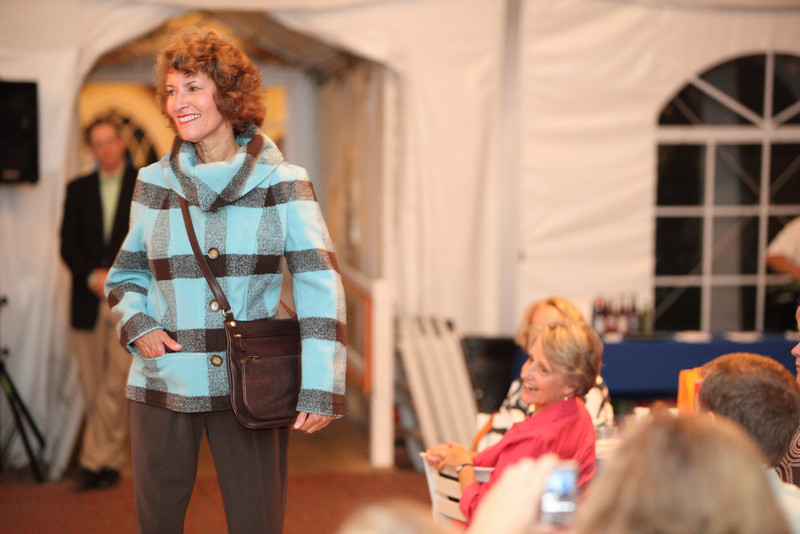 Dianne Newton sports a boald aqua and chocolate checked jacket and trousers by New York company, Composed.