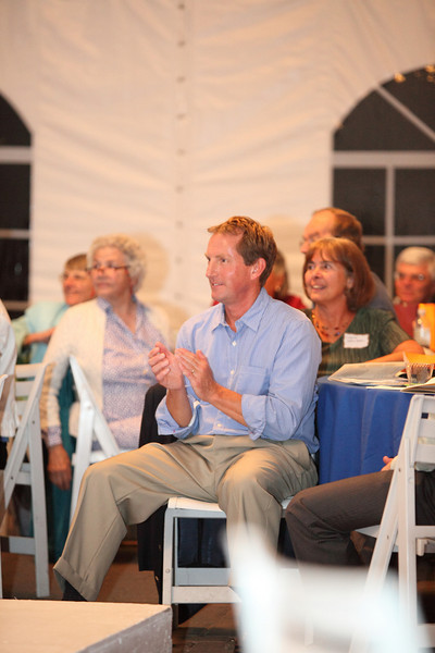 Don Siegrist, husband of Heidi Siegrist, reacts to Heidi's stroll down the catwalk.