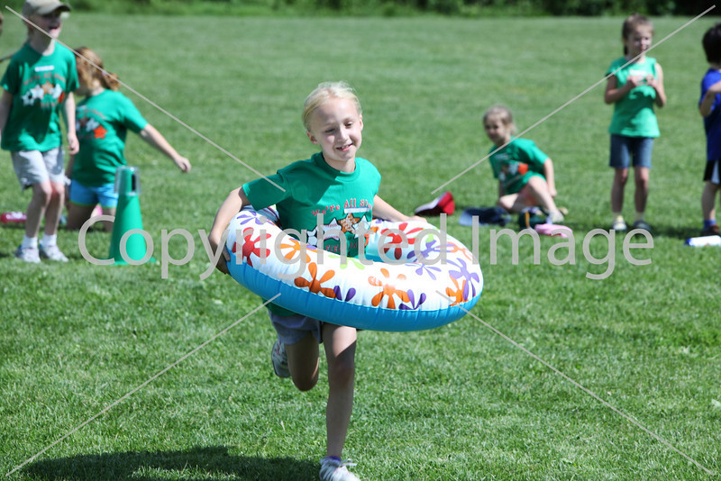 Second-grader Elizabeth Toll participates in the relay race.